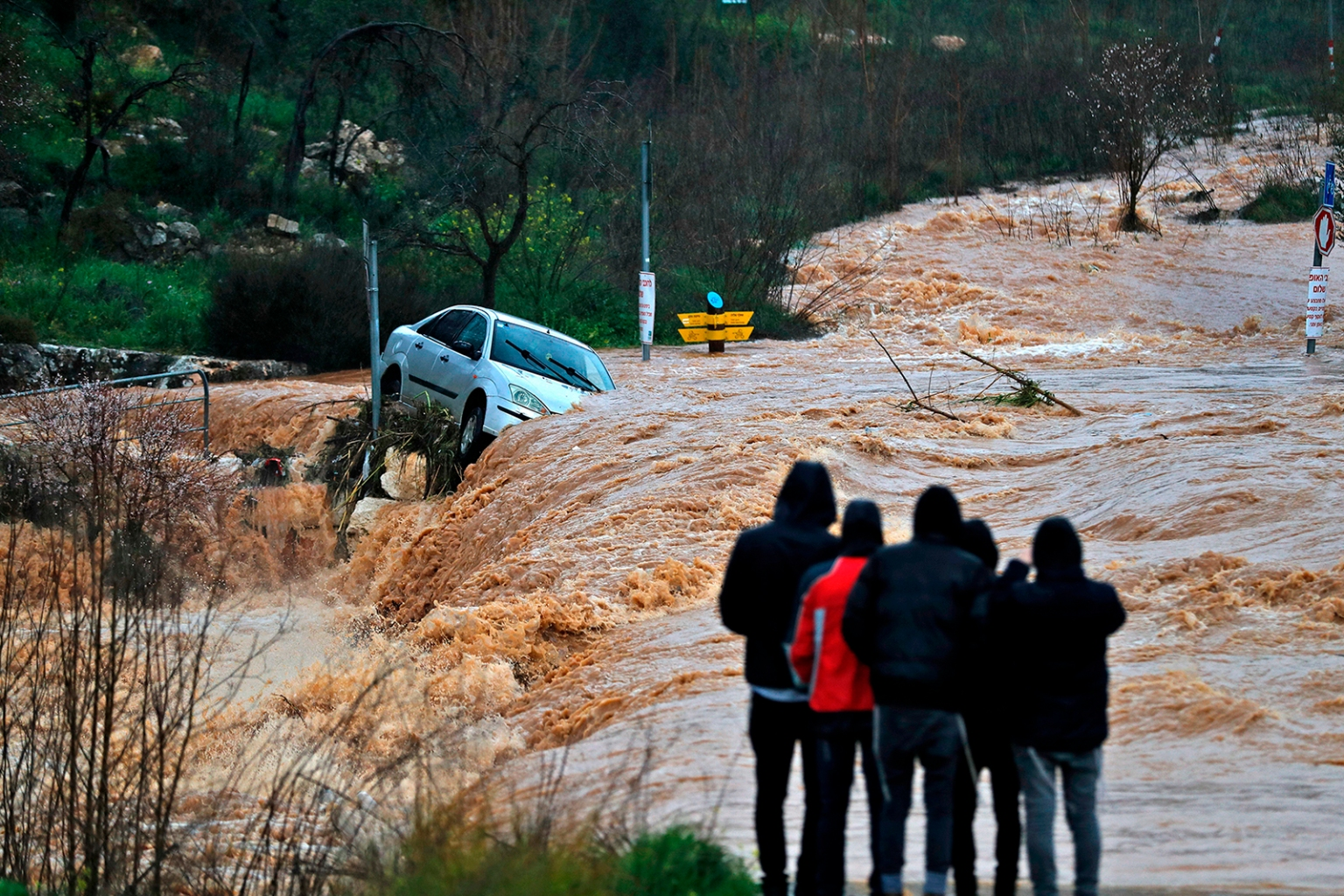 Flash floods caused by torrential rain go down a street on the outskirts of Jerusalem on Feb. 28. AHMAD GHARABLI/AFP/Getty Images