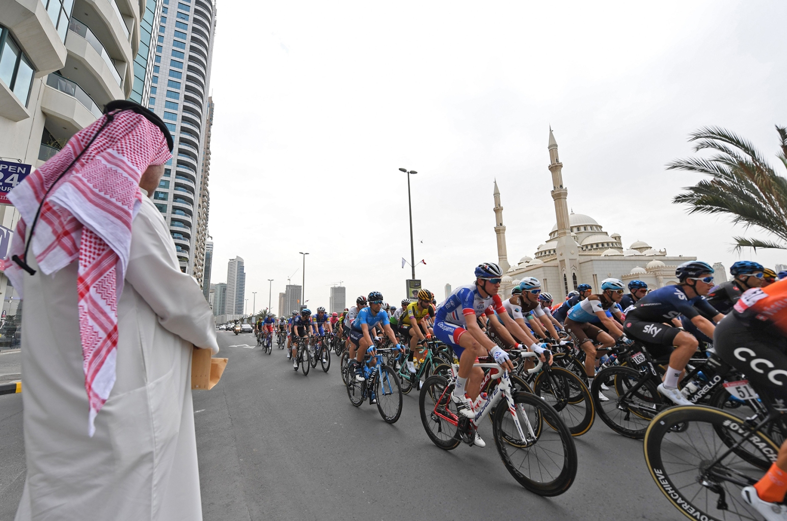 The pack of cyclists rides past during the fifth stage of the UAE tour from Sharjah to Khor Fakkan on Feb. 28. GIUSEPPE CACACE/AFP/Getty Images