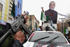 A protestor aims a gun at an effigy of Indian Prime Minister Narendra Modi at a rally in Quetta, Pakistan on March 1. (Bananas Khan/AFP/Getty Images)