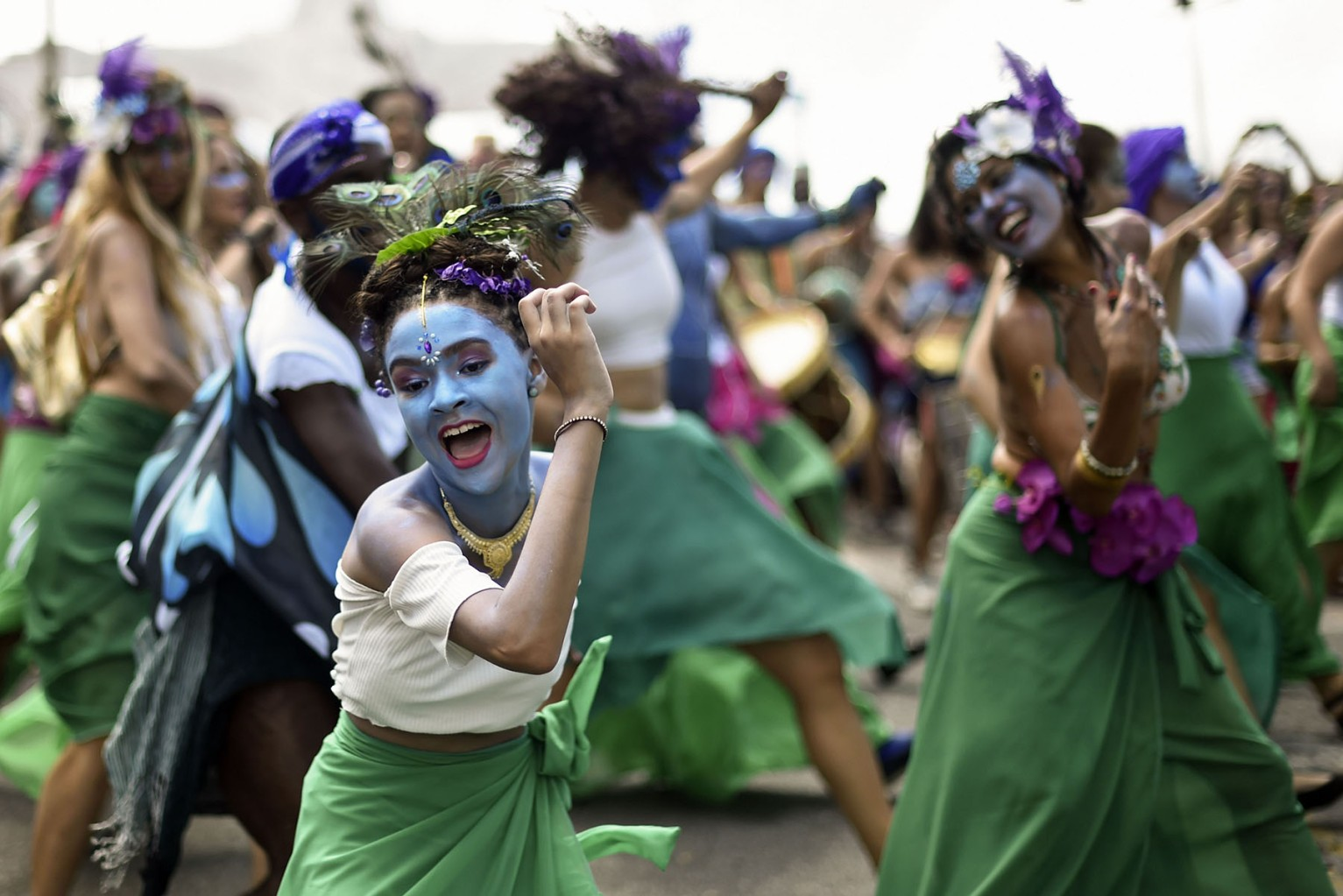 "Members of the ""Pena de Pavao de Krishna"" traditional carnival group, which celebrates Indian deities, perform in Belo Horizonte, Brazil, on March 3. DOUGLAS MAGNO/AFP/Getty Images"