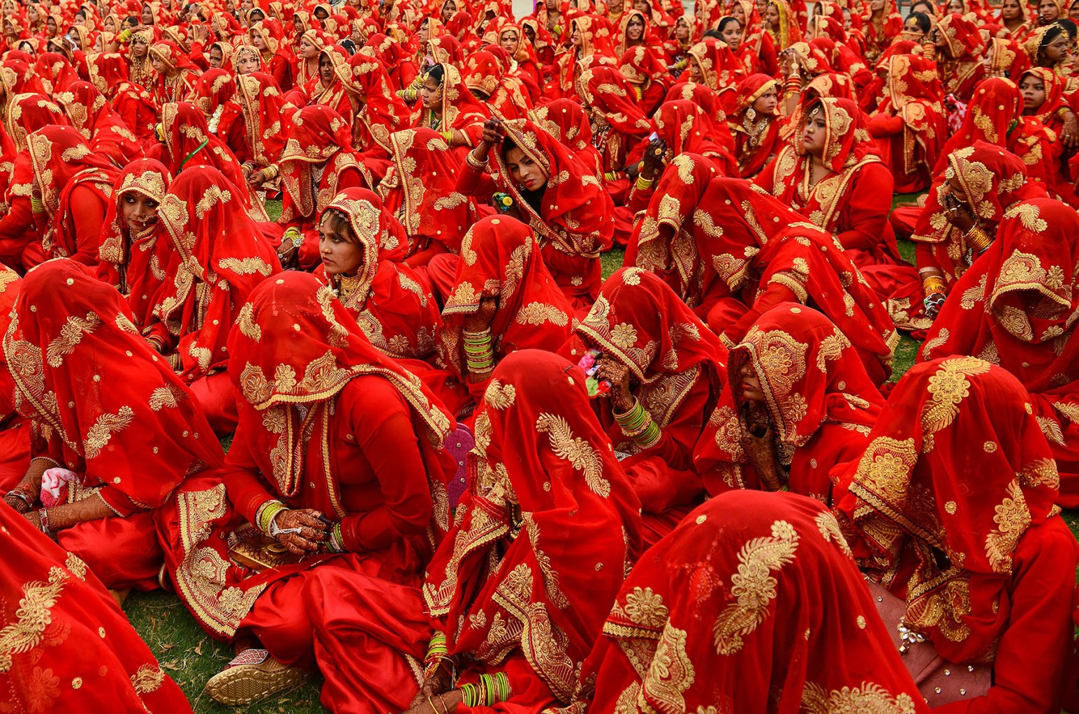Indian Muslim brides-to-be gather as they participate in a mass wedding ceremony in Ahmedabad on March 3. SAM PANTHAKY/AFP/Getty Images