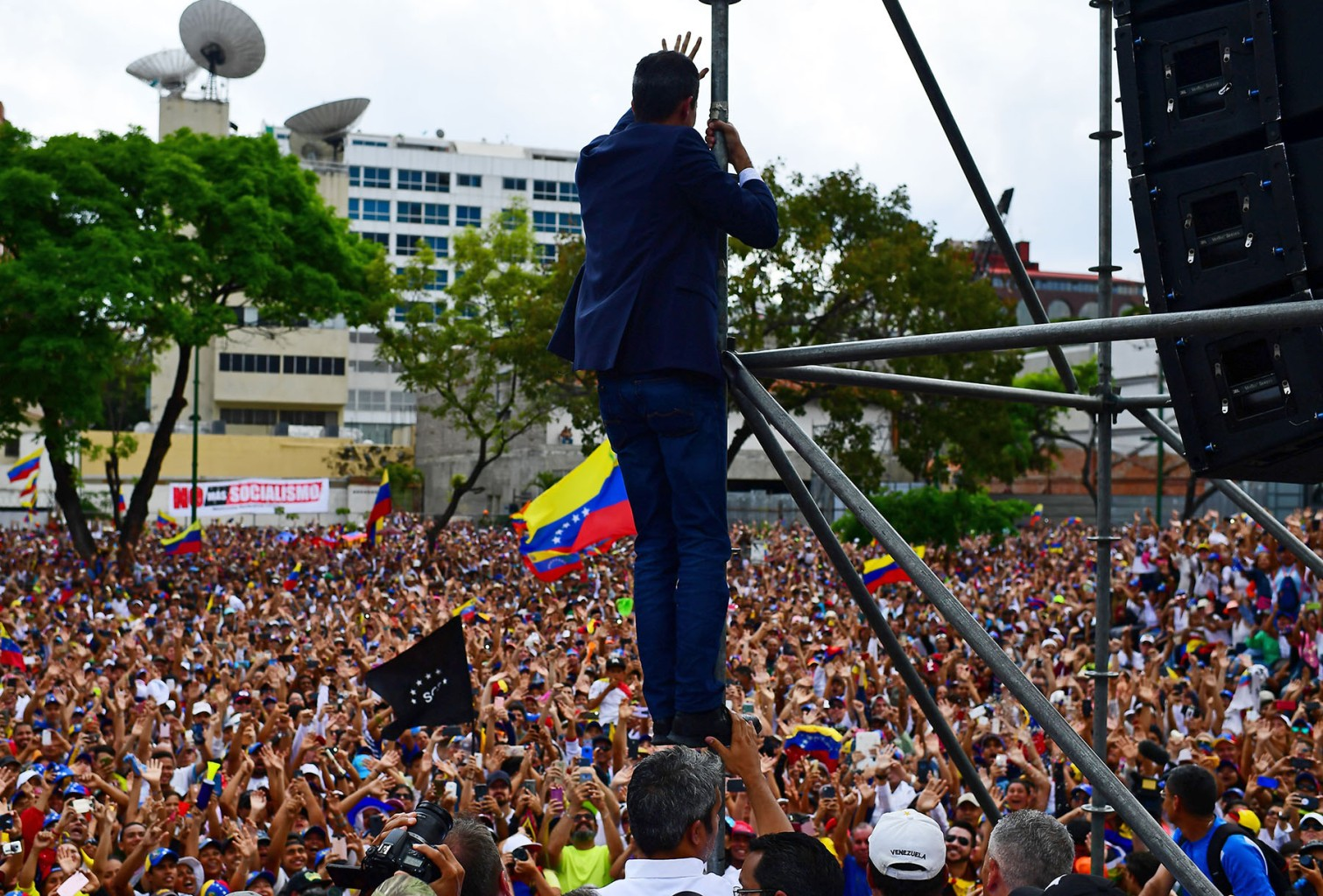 Venezuelan opposition leader Juan Guaidó waves to the crowd during a rally upon his arrival in Caracas on March 4. RONALDO SCHEMIDT/AFP/Getty Images
