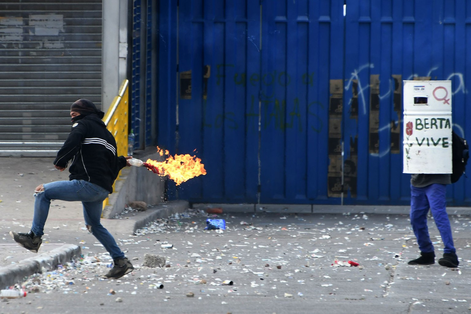 A student throws a Molotov cocktail during clashes with the riot police which erupted during a protest to demand punishment for the murder of Honduran indigenous leader and environmentalist Berta Caceres in Tegucigalpa on March 4. ORLANDO SIERRA/AFP/Getty Images