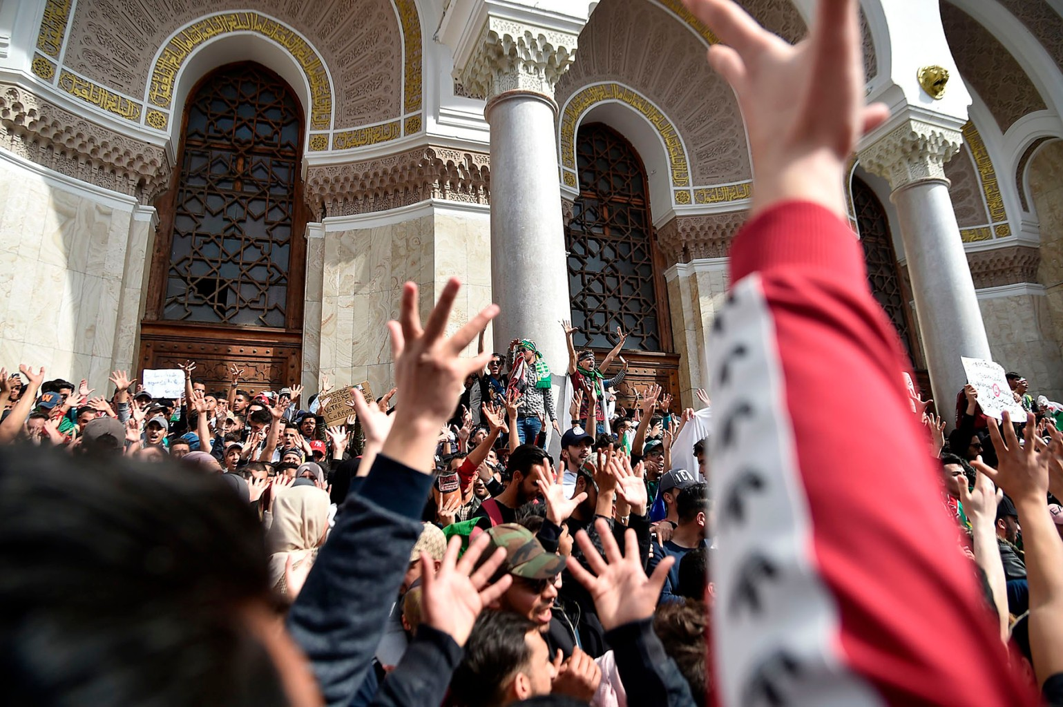 Algerian students demonstrate in the capital Algiers against their ailing president's bid for a fifth term on March 5. (Ryad Kramdi/AFP/Getty Images)