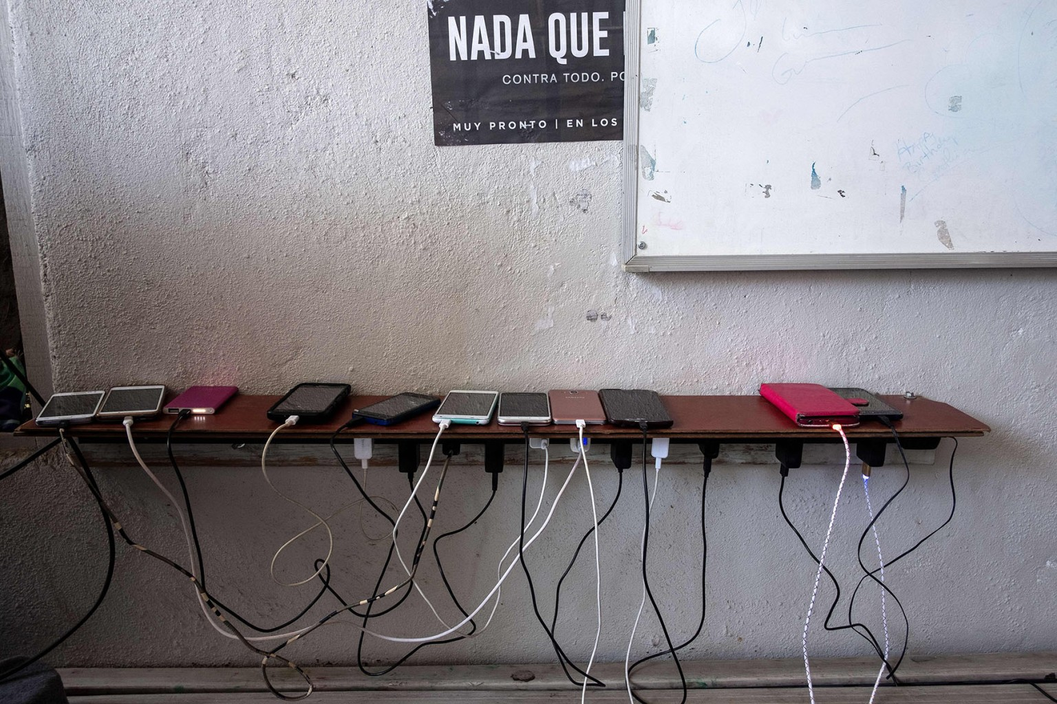 Cellphones of migrants seeking asylum in the United States are seen charging in Juventud 2000 migrant shelter in Tijuana, Mexico, on March 5. GUILLERMO ARIAS/AFP/Getty Images