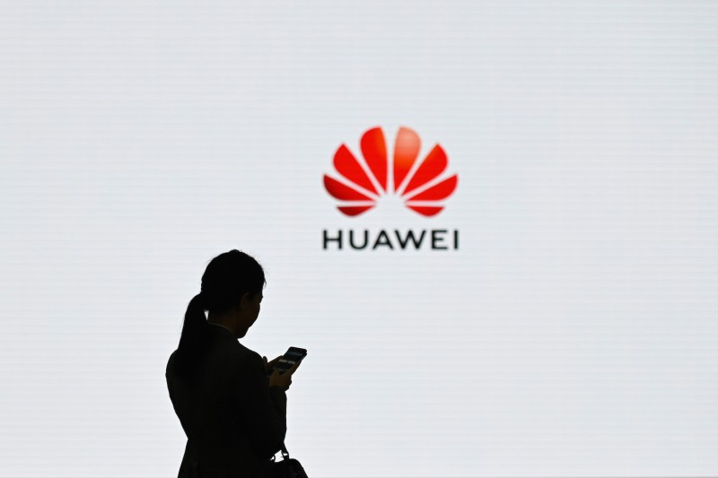 A staff member of Huawei uses her mobile phone at the Huawei Digital Transformation Showcase in Shenzhen, in China's Guangdong province, on March 6. (Wang Zhao/AFP/Getty Images)