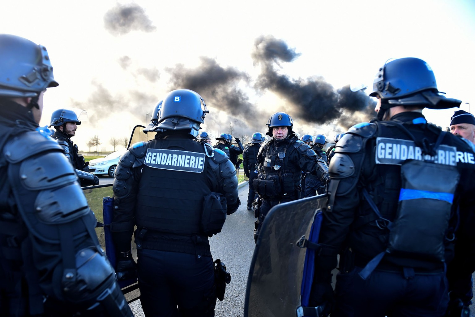 French gendarmes arrive for evacuation as prison guards block the entrance to the penitentiary center of Alencon, in Conde-sur-Sarthe, northwestern France, on March 7, two days after a prison inmate seriously wounded two guards in a knife attack before being detained in a police raid. JEAN-FRANCOIS MONIER/AFP/Getty Images