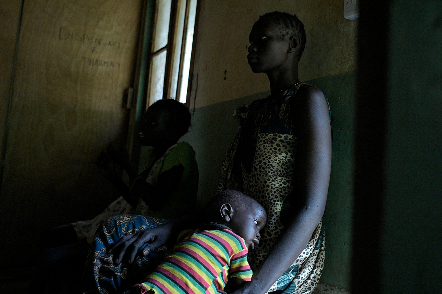 A mother and her sick son wait for treatment at the Udier primary health and care center in South Sudan on March 7. SIMON MAINA/AFP/Getty Images