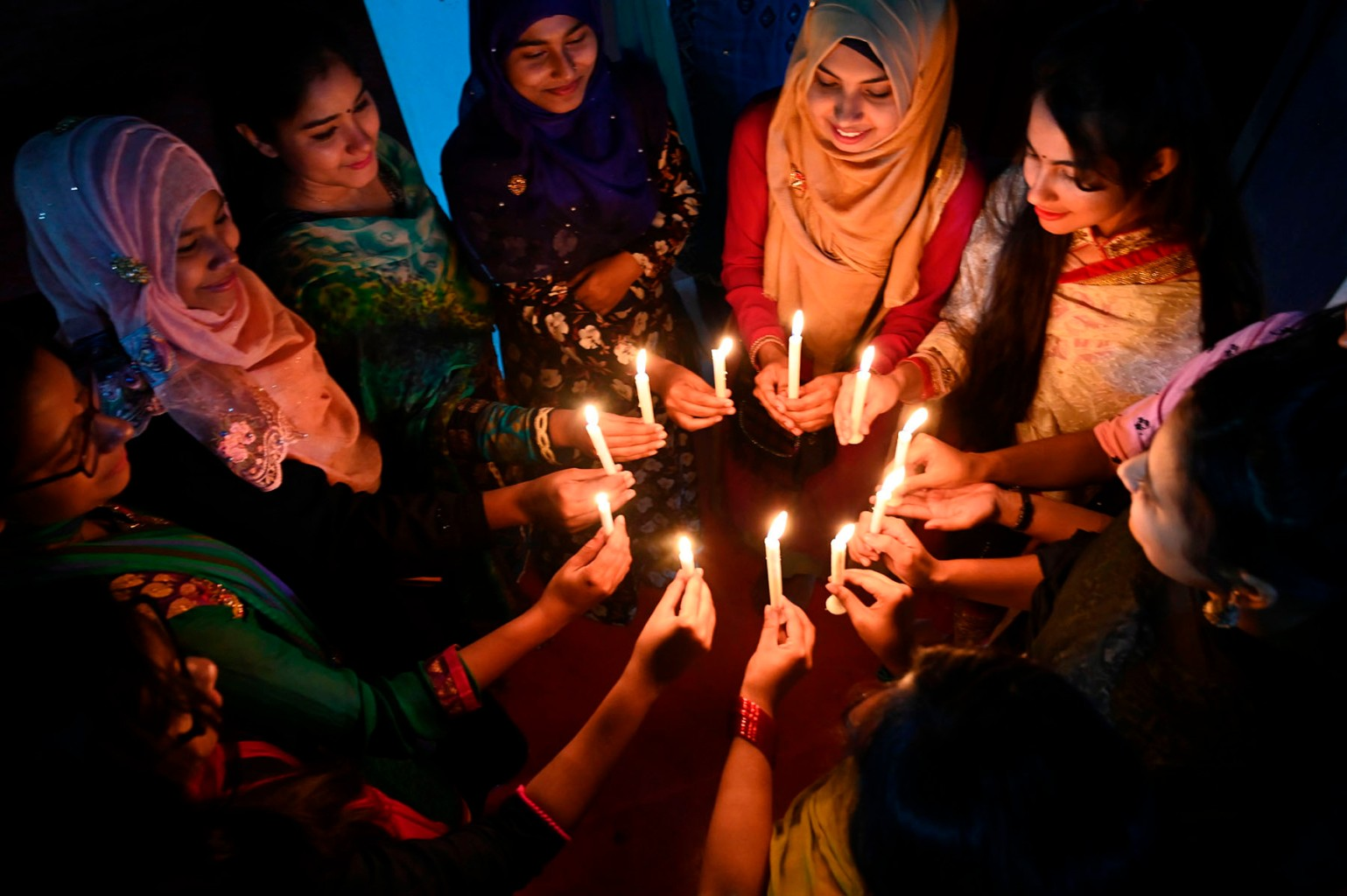 Bangladeshi women attend a candlelight vigil to mark International Women's Day in Dhaka late on March 7. MUNIR UZ ZAMAN/AFP/Getty Images