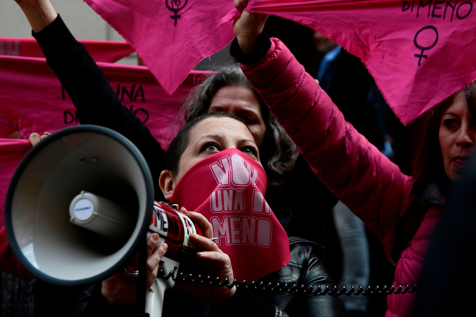"Women from the feminist movement ""Non Una Meno"" (Not One Less) stage a gathering in front of the Labour Ministry in Rome on International Women's Day on March 8 to protest male violence against women, gender discrimination, and harassment in the workplace. FILIPPO MONTEFORTE/AFP/Getty Images"