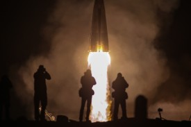 A Soyuz-FG rocket booster carrying a spacecraft with Roscosmos cosmonaut Alexei Ovchinin and NASA astronauts Nick Hague and Christina H. Koch lifts off from Kazakhstan on March 14. (Sergei Savostyanov/TASS/Getty Images)
