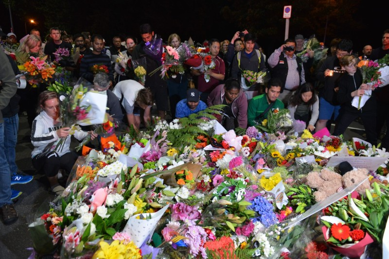 People lay flowers and notes to pay tribute to those killed in a shooting the day before at Al Noor Mosque and Linwood Mosque in Christchurch, New Zealand, on March 16. (Recep Sakar/Anadolu Agency/Getty Images)