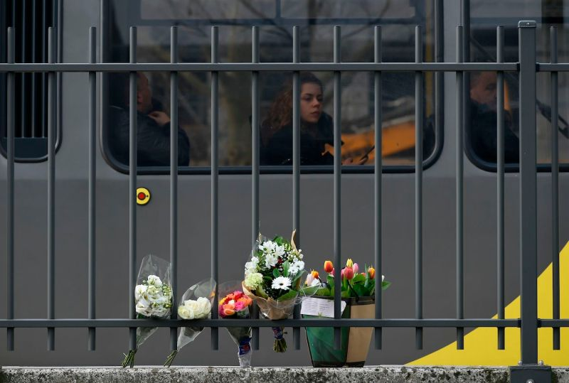 A passenger in a tram looks at flowers displayed near the scene of the fatal shooting in Utrecht, the Netherlands, on March 19. (John Thys/AFP/Getty Images)