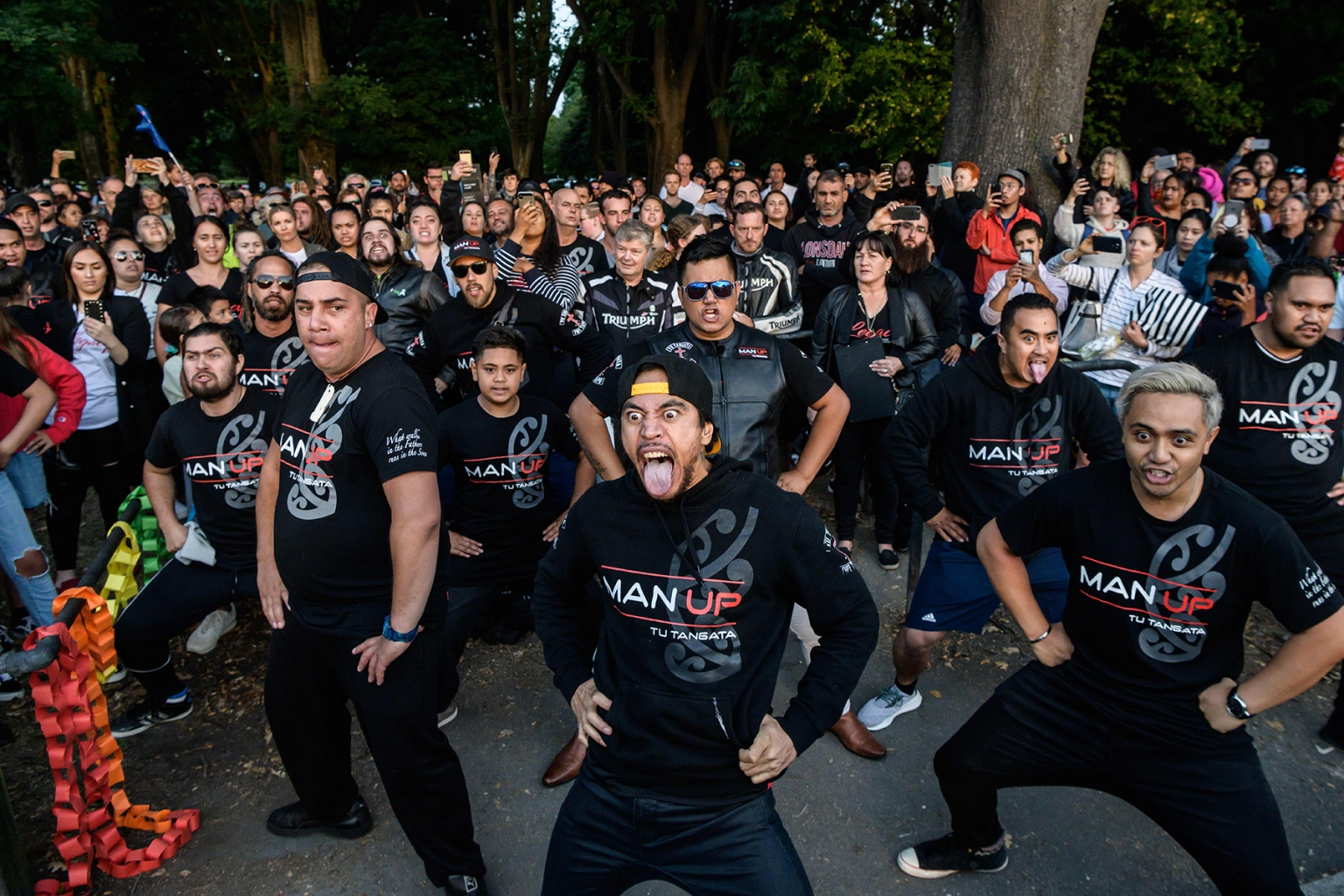 Members of different biker gangs perform the haka—a ceremonial Maori dance—as a tribute to victims in Christchurch, New Zealand, on March 20. ANTHONY WALLACE/AFP/Getty Images