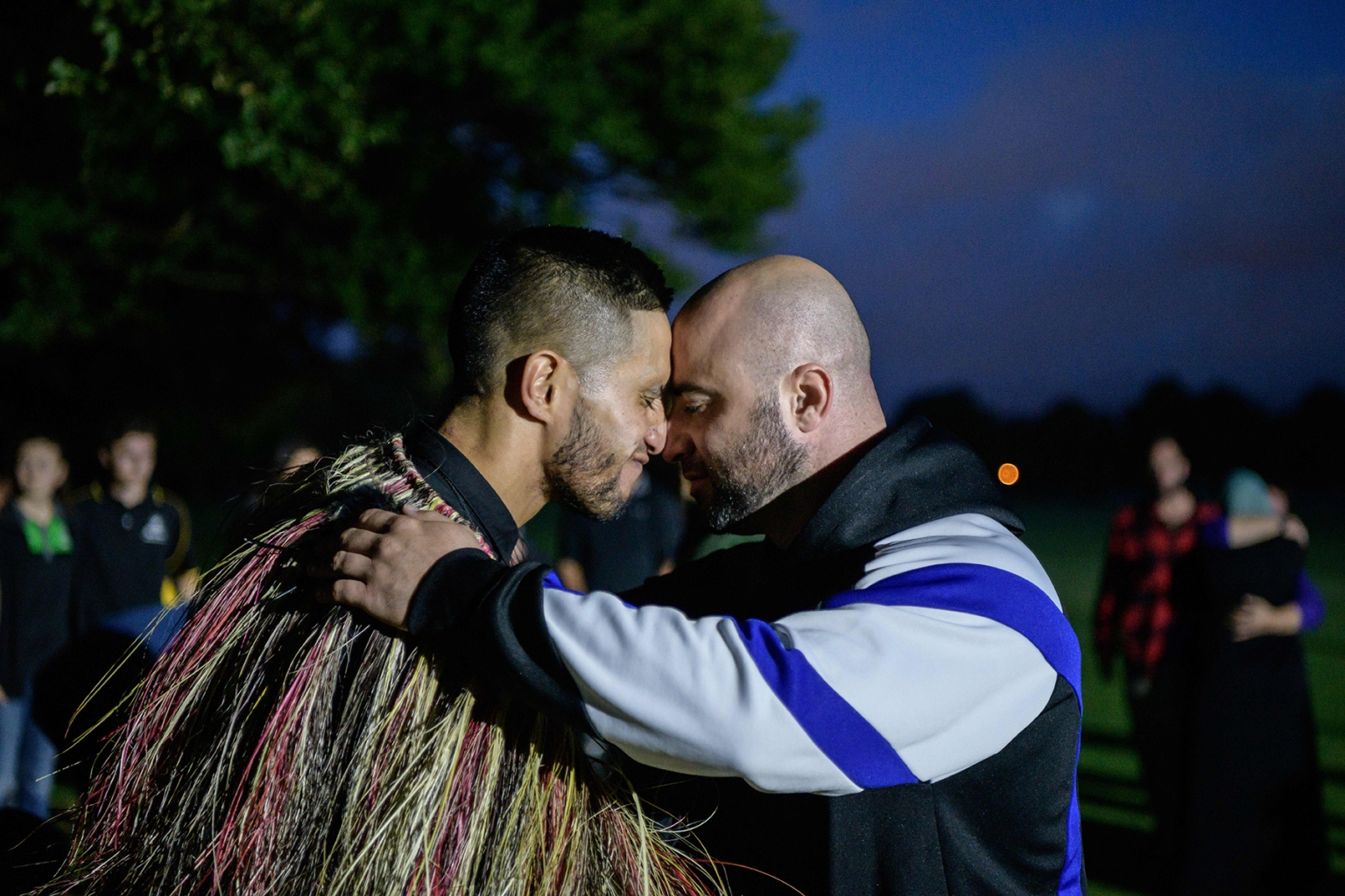 "A Muslim man, right, and another local perform a traditional Maori ""hongi"" greeting, a touching of noses, after Muslims prayed in front of the Al Noor mosque following a mass haka in Christchurch on March 20. ANTHONY WALLACE/AFP/Getty Images"