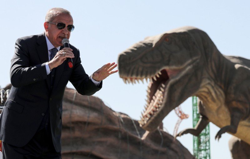 Turkish President Recep Tayyip Erdogan delivers a speech next to a model dinosaur during the opening ceremony of the Wonderland Eurasia theme park in Ankara on March 20, 2019. (Adem Altan/AFP/Getty Images)
