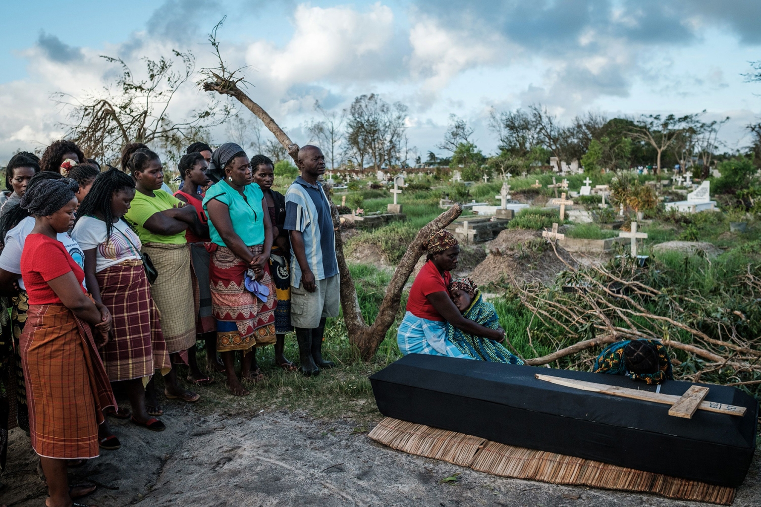 Rebecca Albino mourns beside the coffin of her husband during his funeral on March 20 following a deadly cyclone that hit Beira, Mozambique, and killed hundreds there and in neighboring Zimbabwe. YASUYOSHI CHIBA/AFP/Getty Images