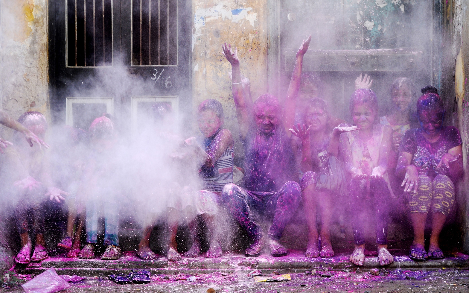 Indian children throw colored powder in the air during Holi spring festival celebrations in Chennai on March 21. ARUN SANKAR/AFP/Getty Images