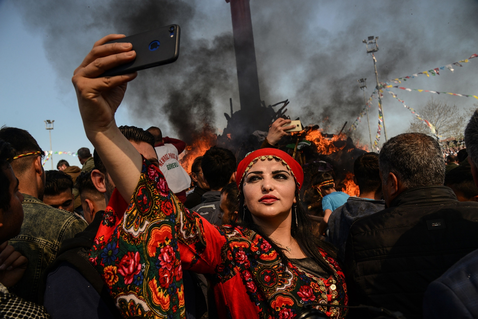 A woman takes a selfie in front of a bonfire as Turkish Kurds gather during Newroz celebrations for the new year in Diyarbakir, southeastern Turkey, on March 21. The ancient Persian festival marks the first day of spring. YAS AKENGIN/AFP/Getty Images