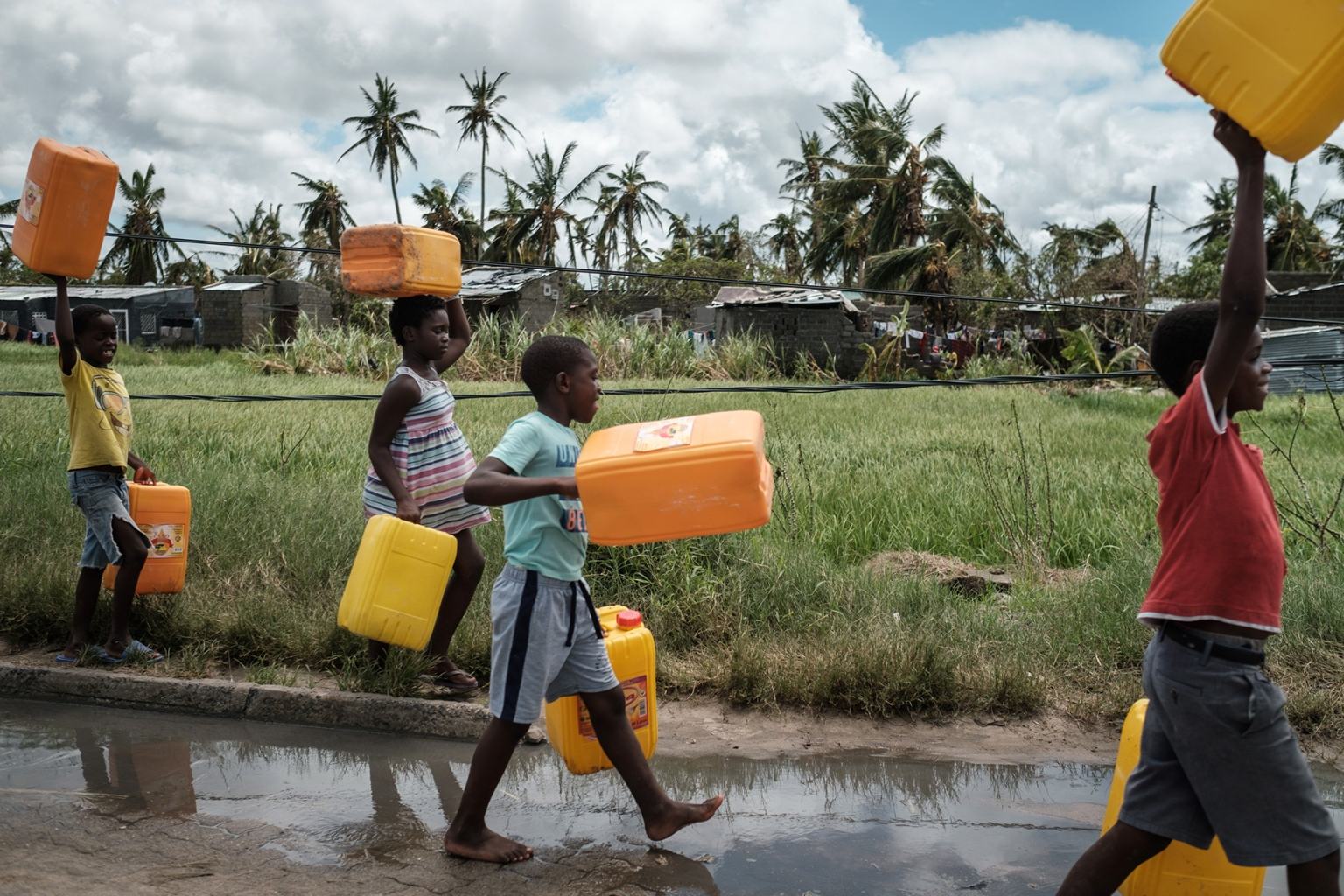 Children carry empty tanks to get water following the cyclone in Beira, Mozambique, on March 21. YASUYOSHI CHIBA/AFP/Getty Images