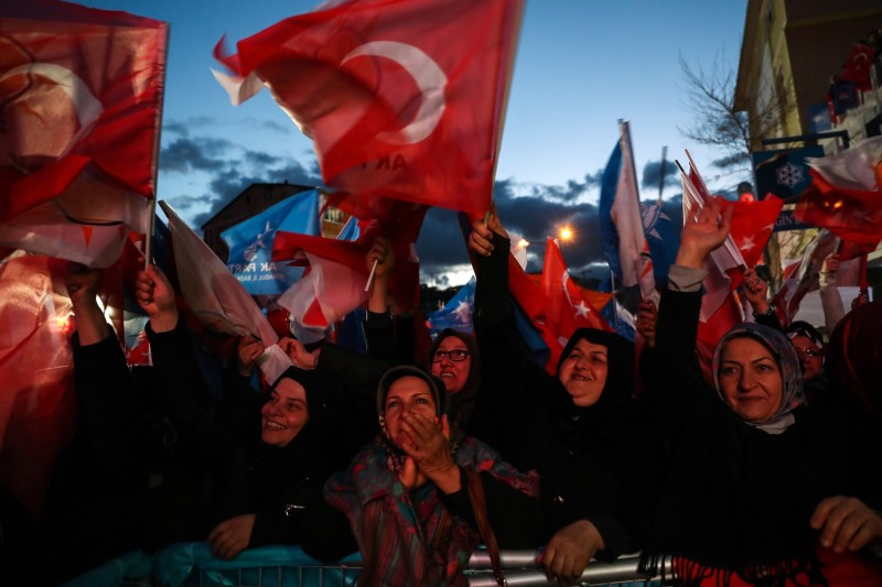 In Istanbul's Sariyer district, people wave flags as Turkish President Recep Tayyip Erdogan makes a speech during a campaign rally on March 29.  (Arif Hudaverdi Yaman/Anadolu Agency/Getty Images)