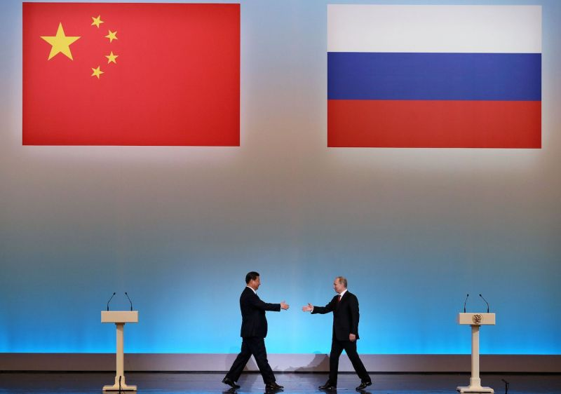 China's President Xi Jinping is welcomed by his Russian counterpart, Vladimir Putin, in Moscow on March 22, 2013. (Sergei Ilnitsky/AFP/Getty Images)