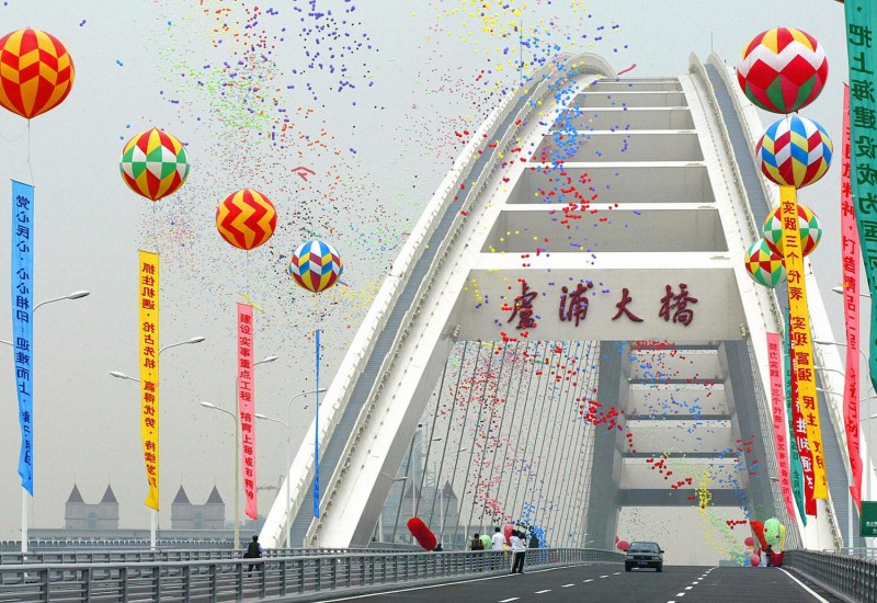 Balloons rise over what was at the time the world's longest steel arch, Lupu Bridge in Shanghai, during the open-to-traffic ceremony on June 28, 2003. (Liu Jin/AFP/Getty Images)