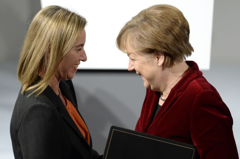 German Chancellor Angela Merkel talks to Federica Mogherini, the European Union's foreign-policy chief, in Munich on Feb. 7, 2015. (Christof Stache/AFP/Getty Images)