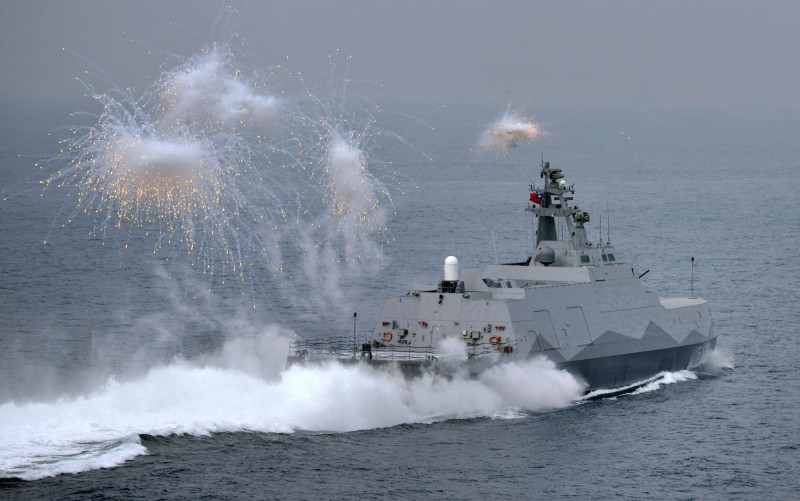 A domestic constructed guided missile corvette ship launches flares during a drill at sea near the naval port in Kaohsiung in southern Taiwan on Jan. 27, 2016. (Sam Yeh/AFP/Getty Images)