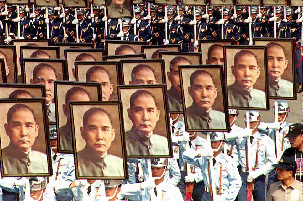 Military cadets carry portraits of Sun Yat-sen, the founding father of the Republic of China, in Taipei, Taiwan, to mark National Day on Oct. 10, 2001. (Tao-Chuan Yeh/AFP/Getty Images)