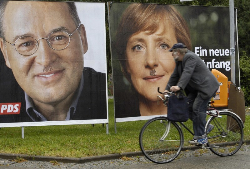 Election billboards of Angela Merke and Gregor Gysi, top candidate of the Left Party, on Sept. 16, 2005 in Berlin. (Eric Feferberg/AFP/Getty Images)