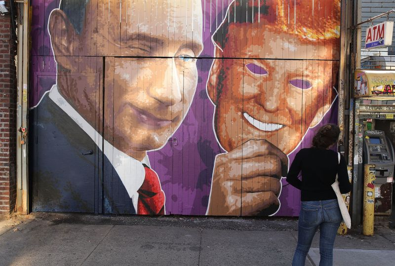 A mural depicting a winking Russian President Vladimir Putin taking off a Donald Trump mask is painted on a storefront outside of the Levee bar in Brooklyn on Feb. 25, 2017. (Spencer Platt/Getty Images)