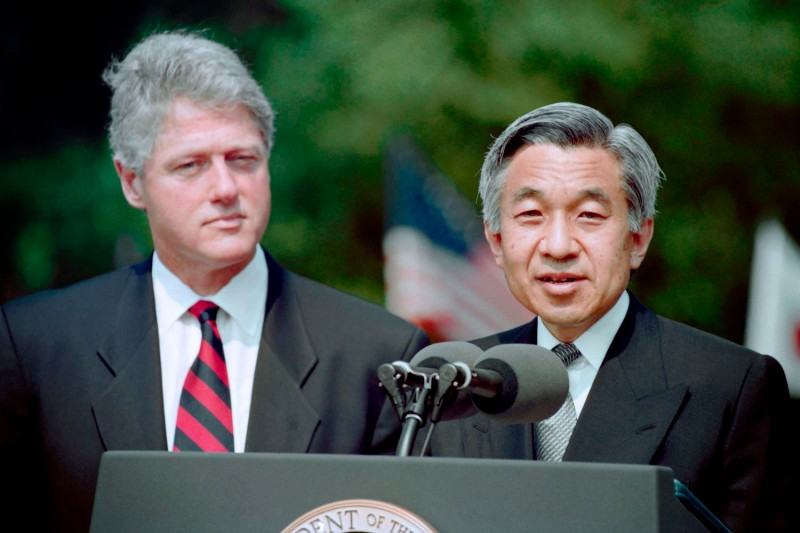 U.S. President Bill Clinton listens as Japanese Emperor Akihito speaks to those attending the formal welcoming ceremony held for himself and Empress Michiko on the White House lawn on June 13, 1994. (Joshua Roberts/AFP/Getty Images)