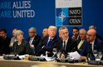 British Prime Minister Theresa May, U.S. President Donald Trump, and NATO Secretary-General Jens Stoltenberg sit at a working dinner meeting at NATO headquarters in Brussels on May 25, 2017. (Matt Dunham/AFP/Getty Images)