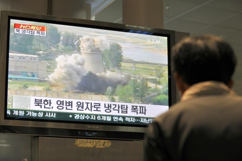 South Korean television shows footage of the public demolition of a North Korean cooling tower at the Yongbyon nuclear complex on June 27, 2008. (JUNG Yeon-je/AFP/Getty Images)