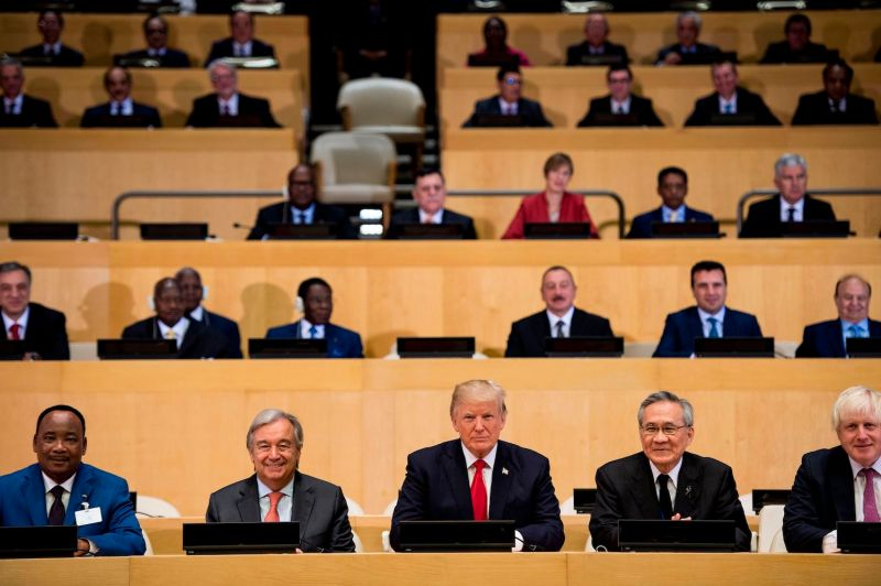 U.N. Secretary-General António Guterres, U.S. President Donald Trump, and others wait for a meeting to begin at the U.N. headquarters in New York on Sept. 18, 2017. (Brendan Smialowski/AFP/Getty Images)