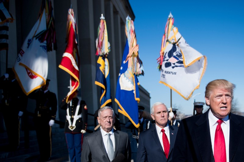 Then-U.S. Secretary of Defense James Mattis and Vice President Mike Pence listen while President Donald Trump speaks to the press before a meeting in the Pentagon in Washington on Jan. 18, 2018. (Brendan Smialowski/AFP/Getty Images)
