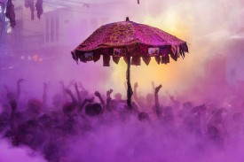Indian devotees and foreign tourists take part in Holi festival celebrations in Pushkar, India, on March 2, 2018. (Shaukat Ahmed/AFP/Getty Images)Holi, the popular Hindu spring festival of colours, is observed in India at the end of the winter season on the last full moon of the lunar month, and will be celebrated on March 2 this year. / AFP PHOTO / Shaukat Ahmed        (Photo credit should read SHAUKAT AHMED/AFP/Getty Images)