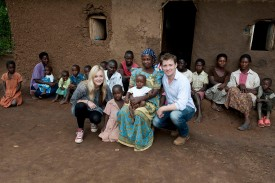 Ben Shephard and Fearne Cotton pose with people in Hoima, Uganda, on Nov. 29, 2009 . The British TV personalities were revisiting Africa to see how money they raised over Red Nose Day is being spent, as well as helping to hand out malaria nets. (Des Willie/Comic Relief via Getty Images)