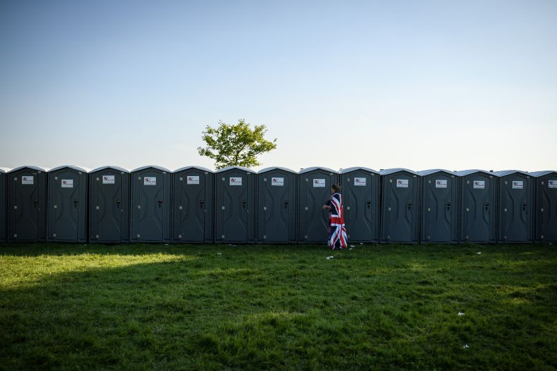 A woman dressed in a flag leaves a portable toilet in Windsor, England, on May 19, 2018. (Leon Neal/Getty Images)