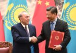Kazakhstan's President Nursultan Nazarbayev shakes hands with Chinese President Xi Jinping during a signing ceremony in the Great Hall of the People in Beijing on June 7, 2018. (Greg Baker-Pool/Getty Images)