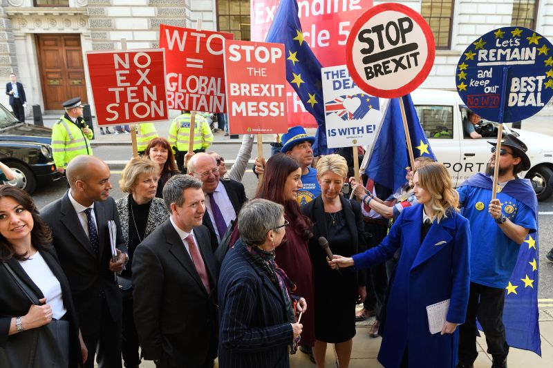 Former Labour and Conservative MPs Heidi Allen (L), Chuka Umunna (2L), Anna Soubry (3L), Chris Leslie (5L), Mike Gapes (6L), Ann Coffey (C), Luciana Berger (5R) and Angela Smith (3R) of the independent group of MPs are surrounded by pro- and anti-Brexit protesters as they arrive for their inaugural meeting at Institute of civil engineers on February 25, 2019 in London.