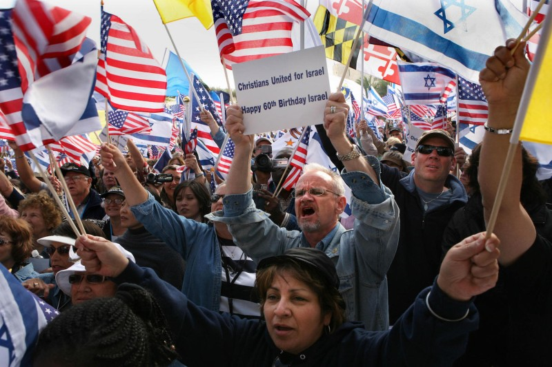 Followers of Evangelical Pastor John Hagee chant slogans in support of Israel as they wave Israeli and U.S. flags during a rally in Jerusalem on April 7, 2008.