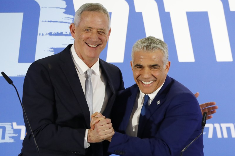 Newly-allied Israeli centrist politicians Benny Gantz (L) and Yair Lapid (R), as they deliver a joint statement in Tel Aviv on Feb. 21.