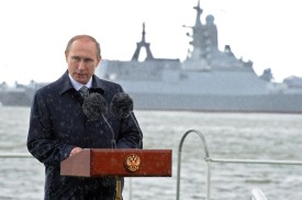 Russian President Vladimir Putin delivers a speech under the rain during celebrations for Navy Day in Baltiysk in the Kaliningrad region on July 26, 2015.