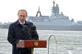 Russian President Vladimir Putin delivers a speech under the rain during celebrations for Navy Day in Baltiysk in the Kaliningrad region on July 26, 2015.