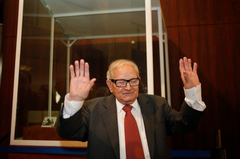 Rafi Eitan, who was a member of the Mossad team that captured Adolf Eichmann in Argentina in 1960, waves to photographers during an exhibition at the Knesset in Jerusalem on December 12, 2011, commemorating the 50th anniversary of the verdict against Eichmann, who was instrumental in the planning and execution the Holocaust.