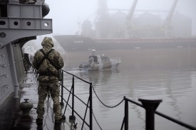 "A Ukrainian soldier stands guard aboard the military vessel ""Dondass"" moored in Mariupol, the Sea of Azov port on Nov. 27, 2018, after three Ukrainian navy vessels were forcibly seized off the coast of Crimea by Russian forces."