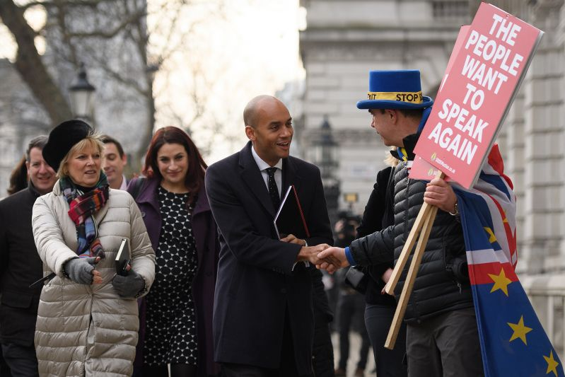 Then-Conservative MP Anna Soubry (L) and then-Labour MPs Luciana Berger (C) and Chuka Umunna (front) are greeted by an anti-Brexit protester as they arrive at the Cabinet Office on January 21, 2019 in London.