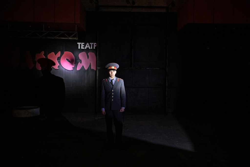 A musician wearing a Soviet militia uniform stands before the entrance of the Ilkhom Theatre in Tashkent, Uzbekistan, on March 13.